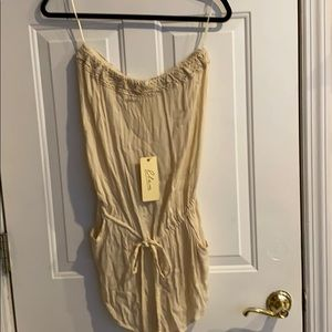 Strapless cream colored romper with embroidery.